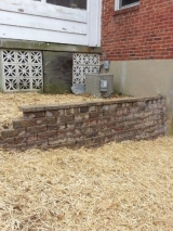 <h5>Retaining Wall After</h5><p>Hay and seed were laid down after we built the retaining wall to protect the grass seed we planted to restore the yard. 																																																																				</p>