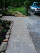 <h5>Paver Walkway After</h5><p>This was originally dirt and grass, but we installed a paver walkway, sloped appropriately to allow for drainage. 																																		</p>